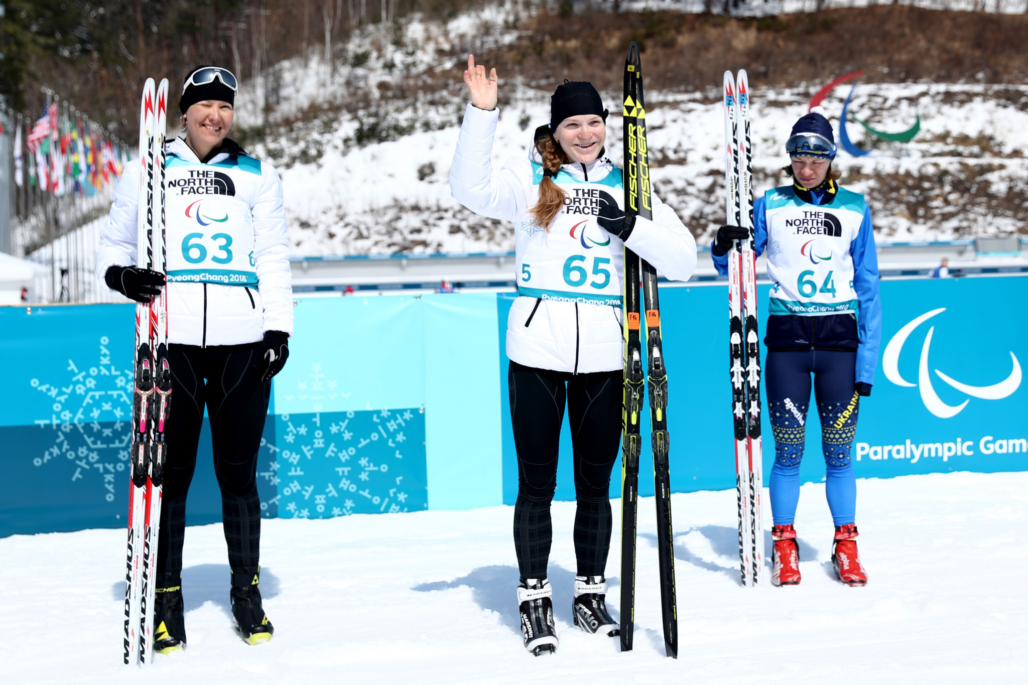 Russia's Ekaterina Rumyantseva, middle, and Anna Milenina, left, secured a Neutral Paralympic Athletes one-two in the women's 6km standing event at Pyeongchang 2018 ©Getty Images