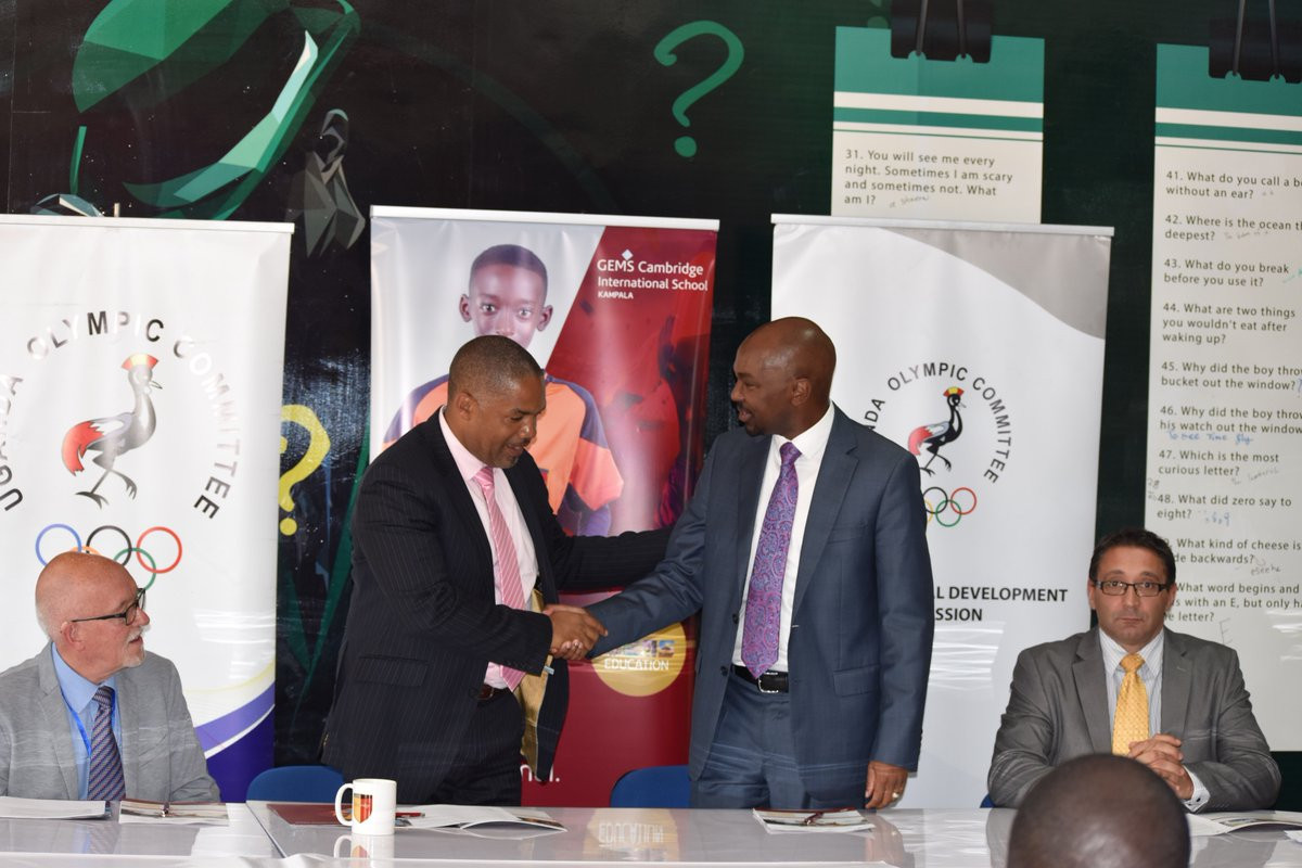 UOC President Willam Blick greets Ernest Murreith ©Uganda Olympic Committee