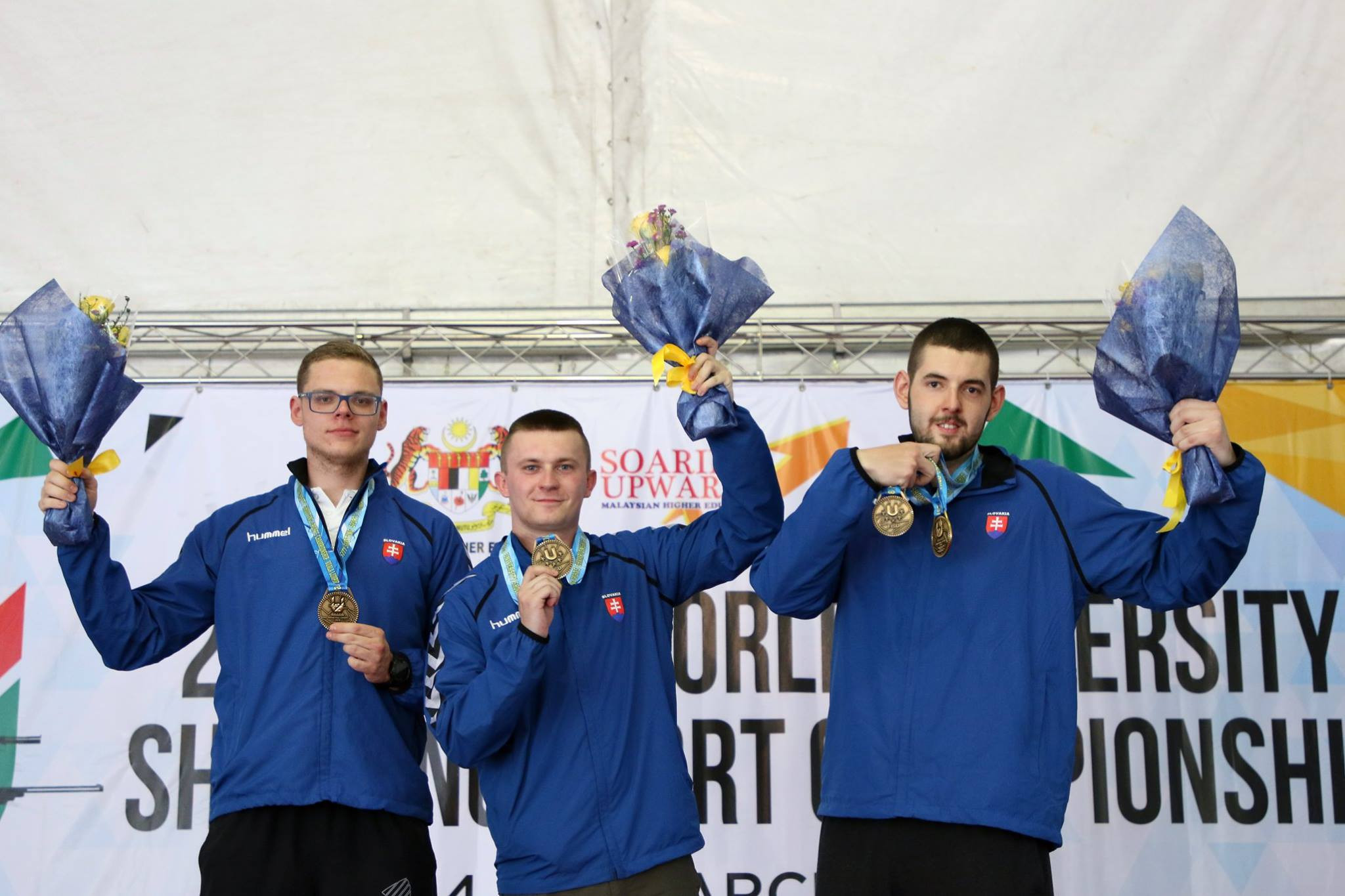 Slovakia celebrated double gold in men's trap competitions ©FISU
