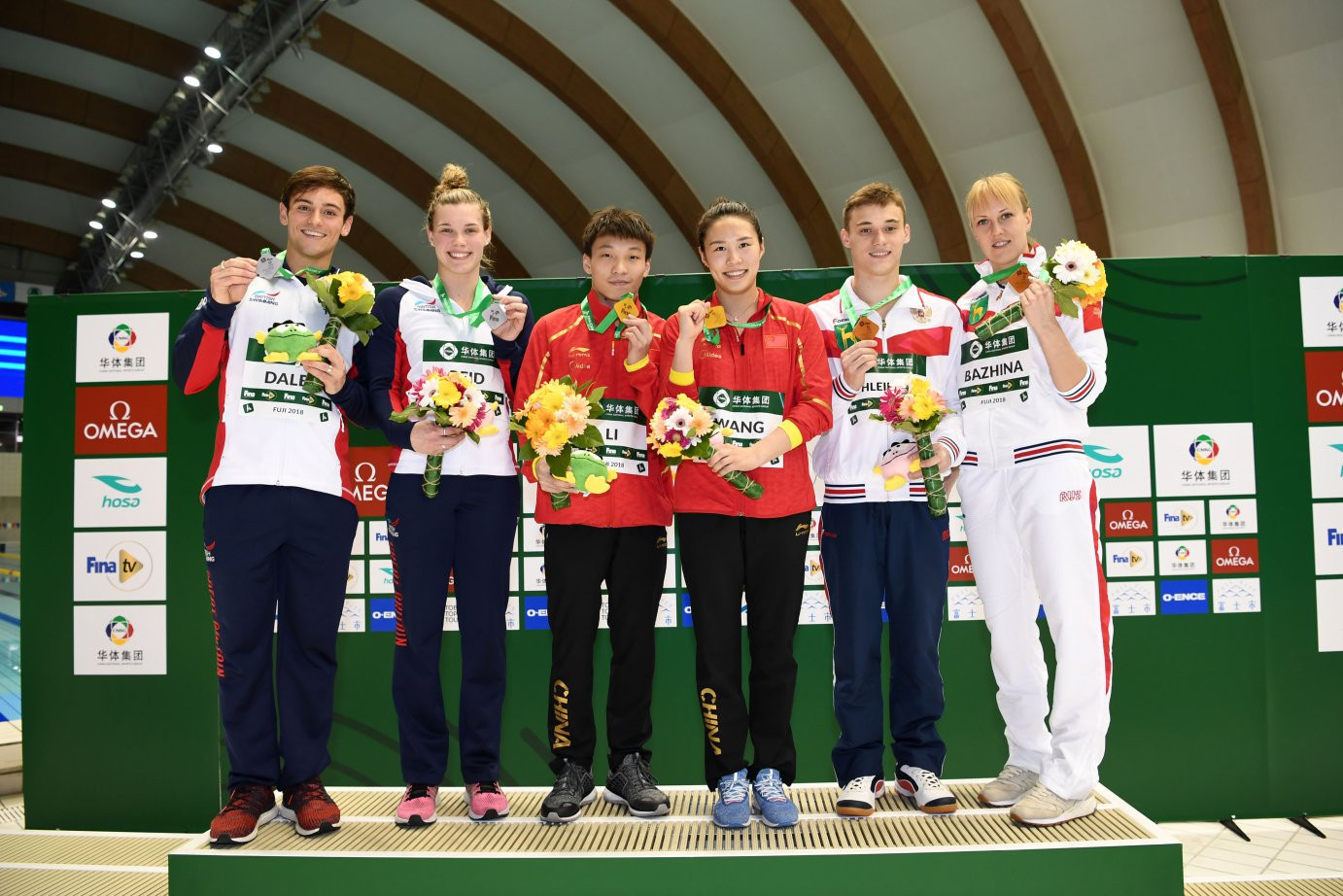 The medallists line up from the final event in the FINA Diving World Series at Fuji - the mixed 3m springboard ©FINA