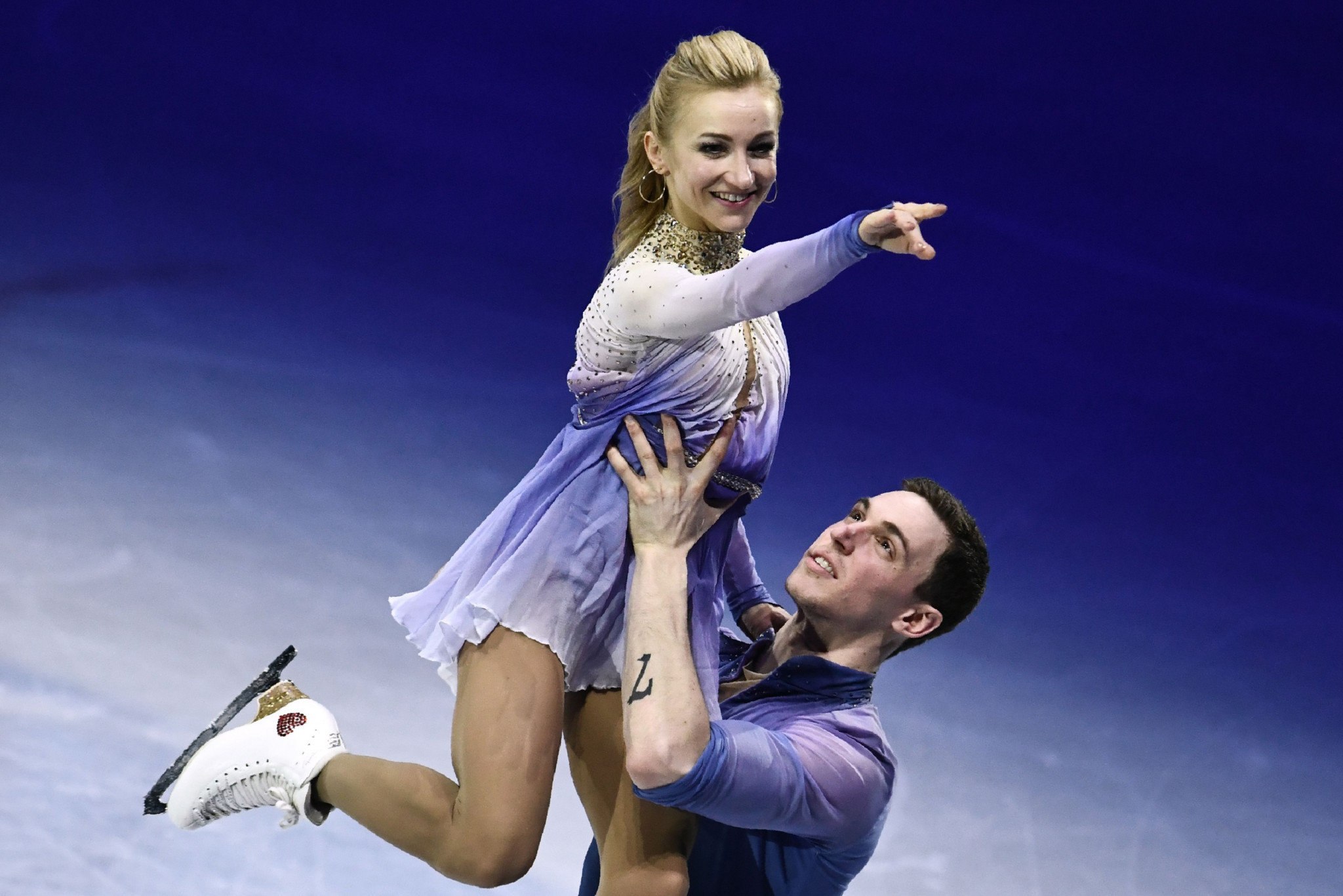 Olympic pairs champions add World Figure Skating Championships gold