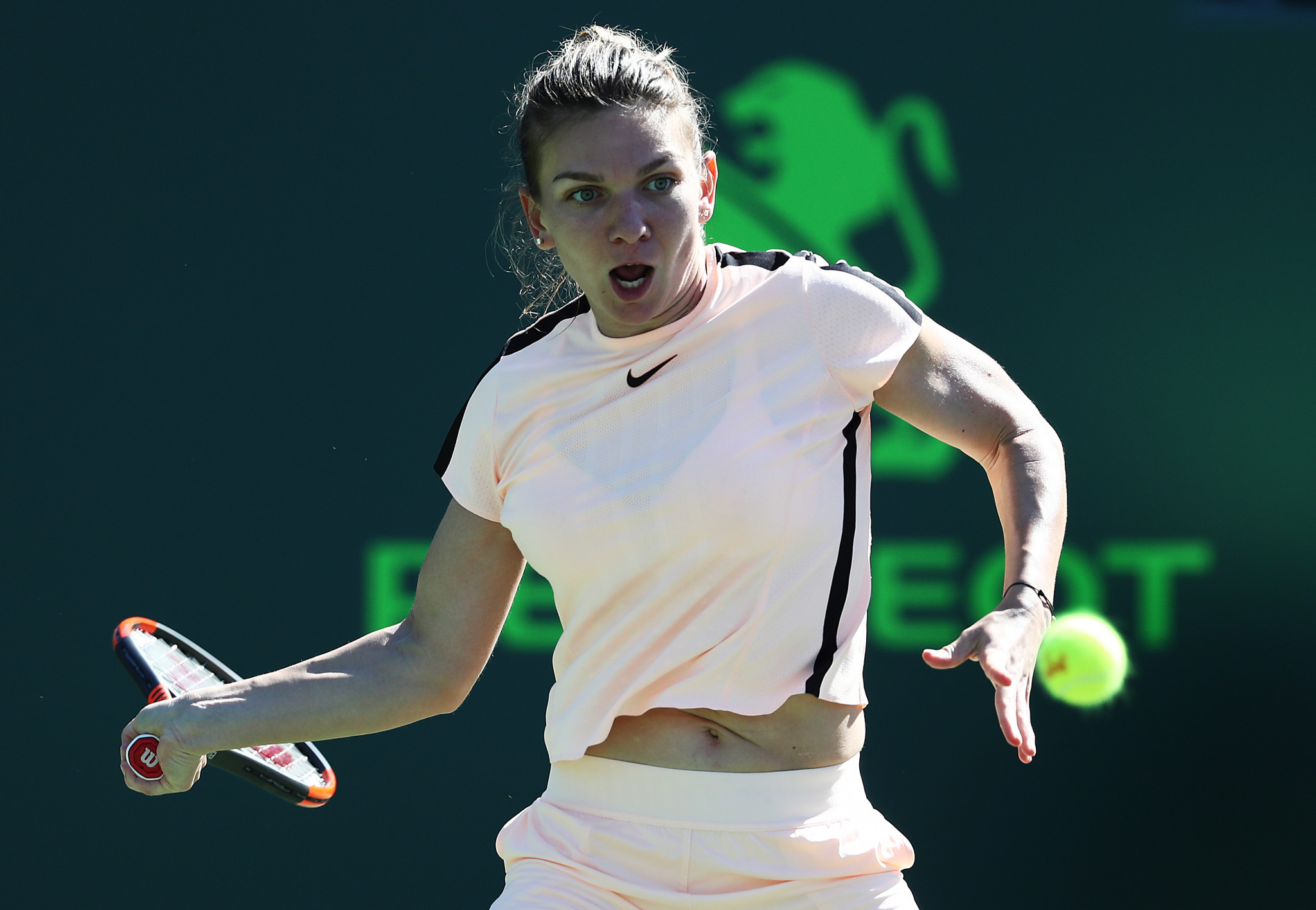 Ranked Halep wins tough 3-setter in Miami