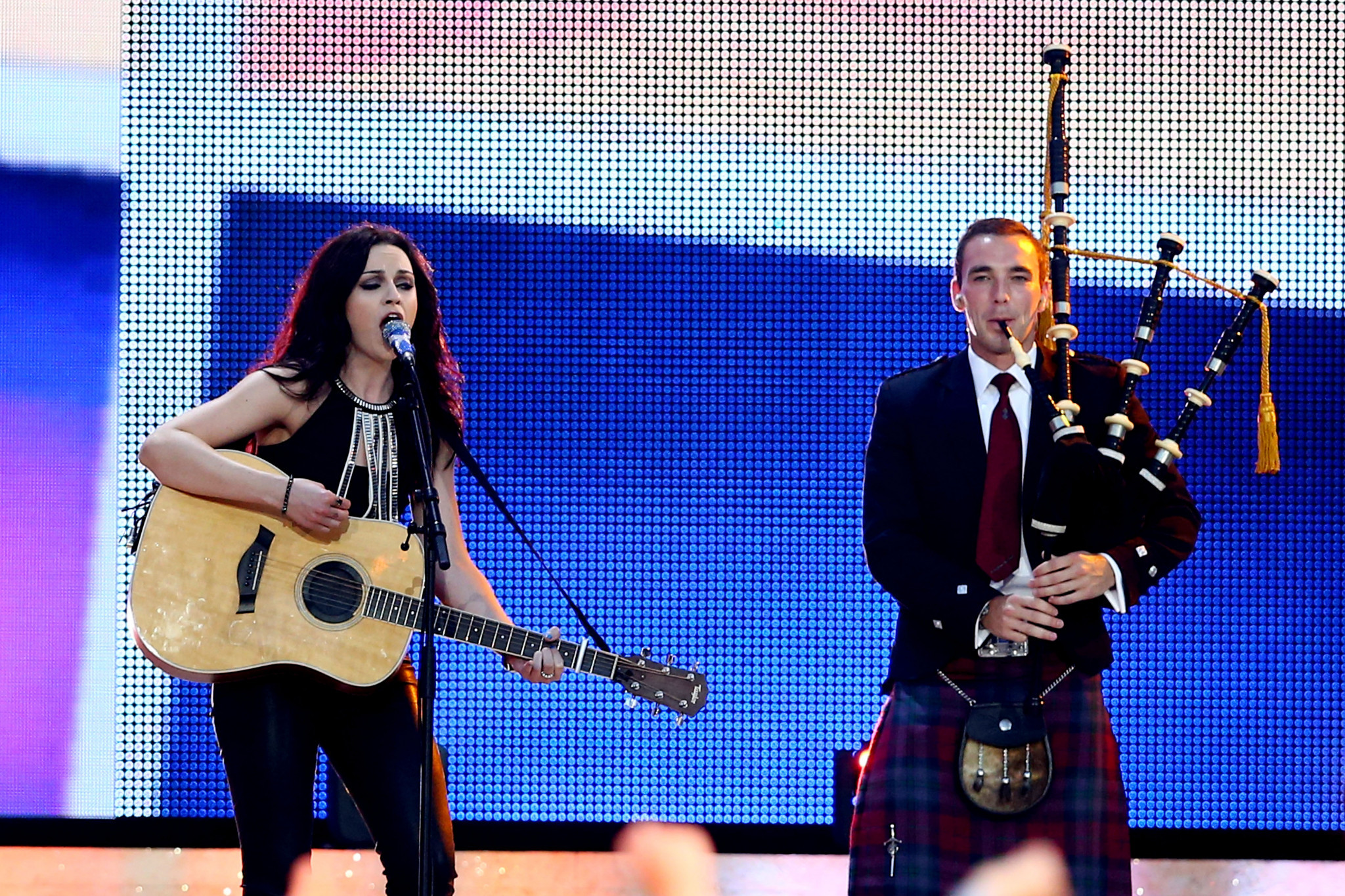 Amy Macdonald performs alongside a piper at the Glasgow 2014 Opening Ceremony ©Getty Images