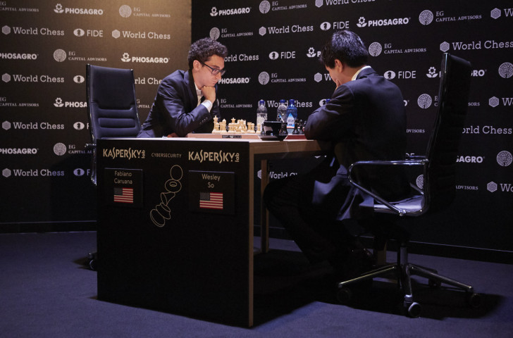 Fabiano Caruana, left, pictured playing US colleague Wesley So, is narrowly ahead in the FIDE Candidates Trophy in Berlin ©Getty Images