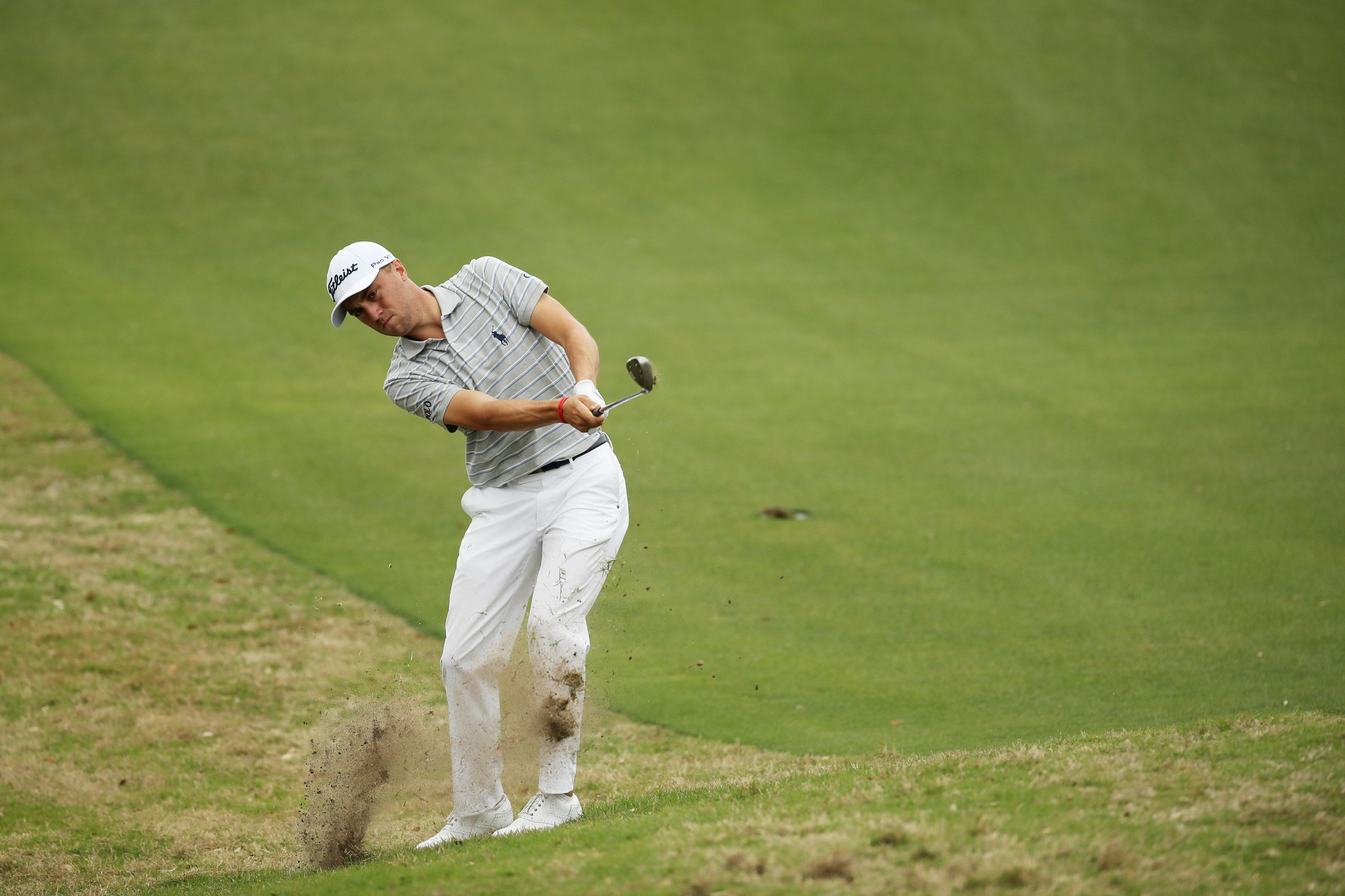 Thomas progresses with ease as McIlroy crashes out at WGC Match Play