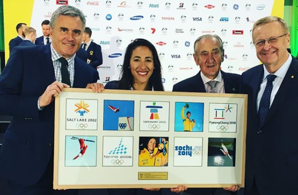 Lydia Lassila, second left, received a special plaque honouring her achievements ©AOC