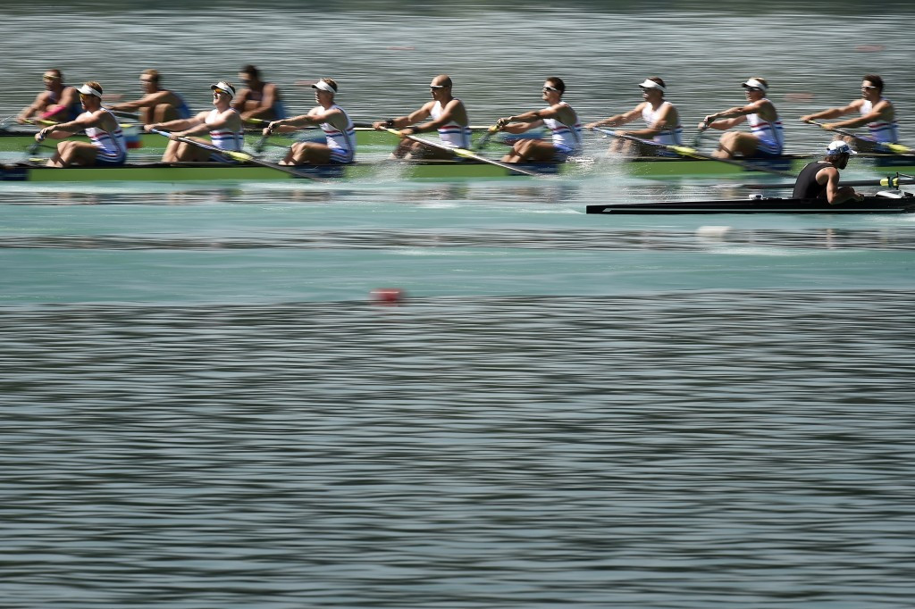 British men's eight holds off Germany to win third world rowing title