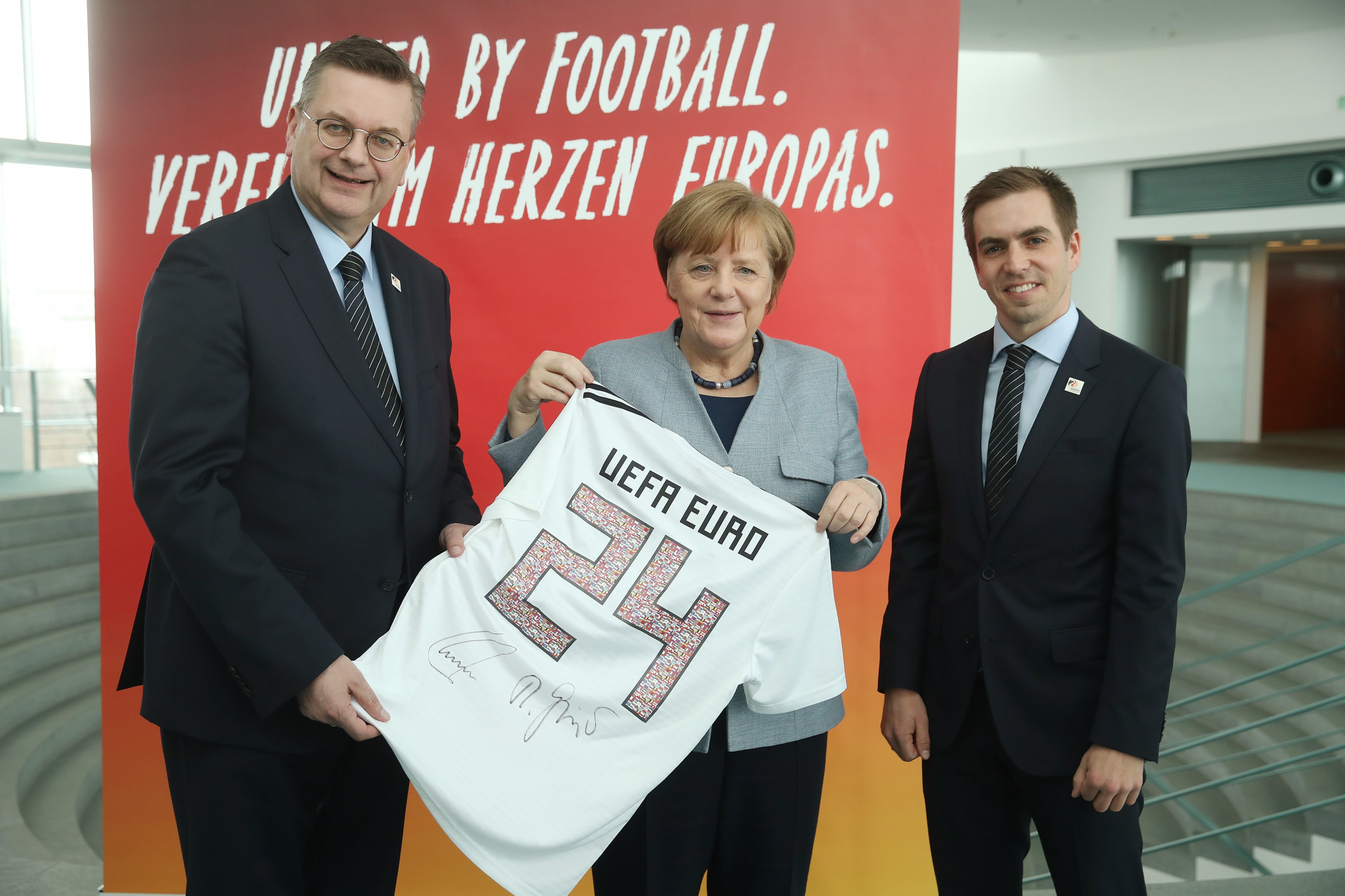 Angela Merkel, centre, recently showed her support for Germany's bid for the UEFA Euro 2024 tournament ©Getty Images