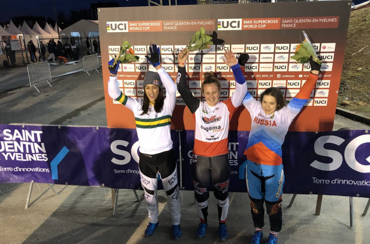 Laura Smulders of The Netherlands, centre, was the winner of the first elite women's race in the UCI BMX Supercross World Cup series which got underway near Paris ©Twitter