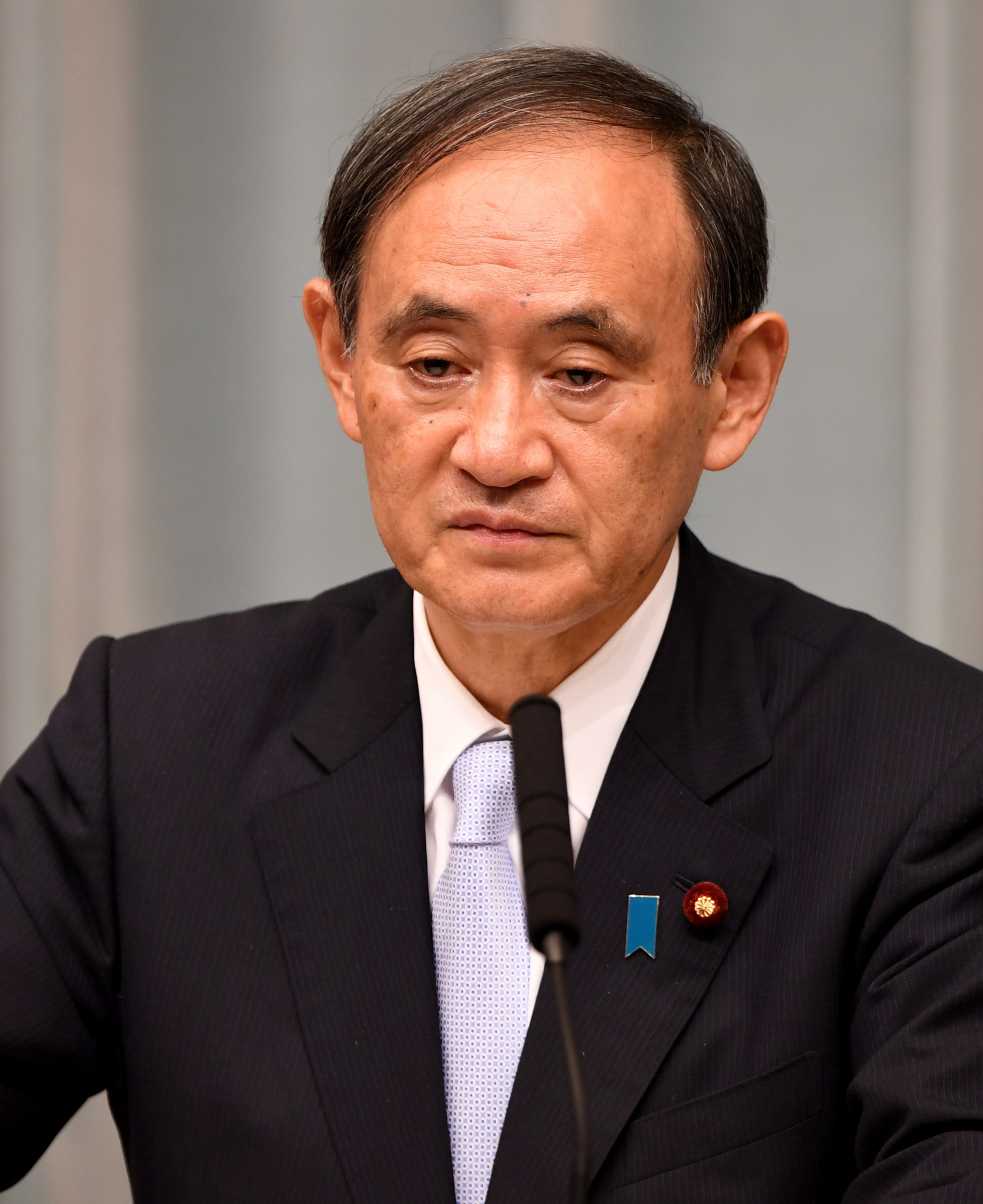 Yoshihide Suga said Japan would pay close attention to North Korea's relationship with the IOC ©Getty Images