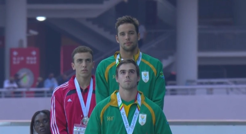 Chad Le Clos (centre) was one South African winner on a day of dominance today ©Brazzaville 2015