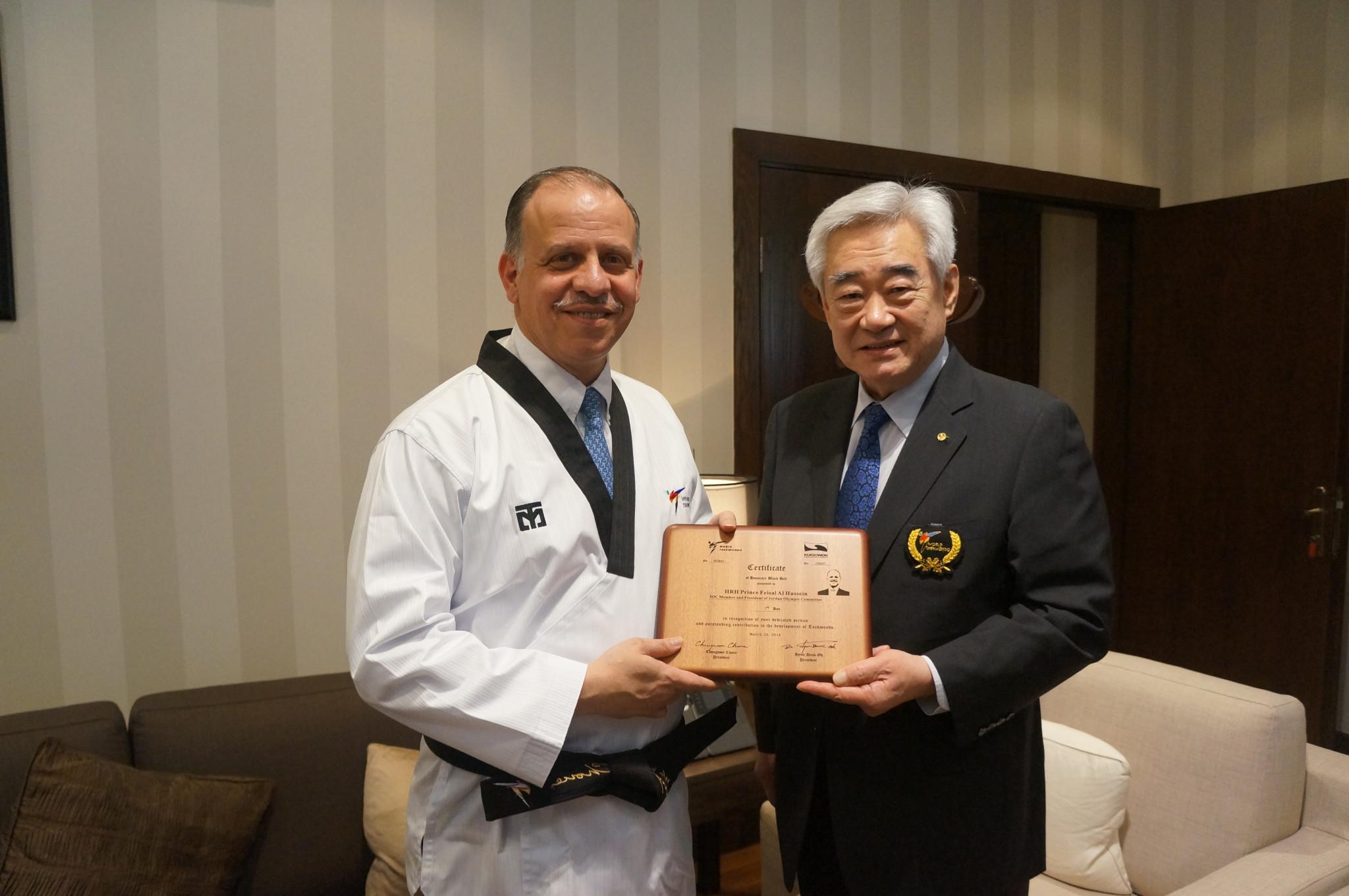 Chungwon Choue presented International Olympic Committee member Prince Feisal Al Hussein with a seventh Dan black belt in Amman ©World Taekwondo