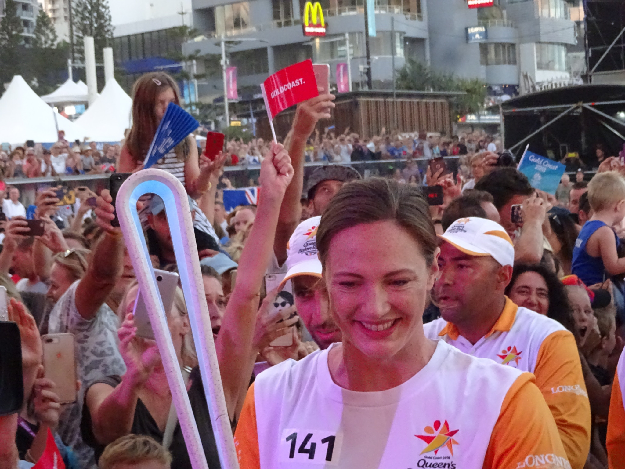 Swimmer Cate Campbell carries the Gold Coast 2018 Baton ©ITG