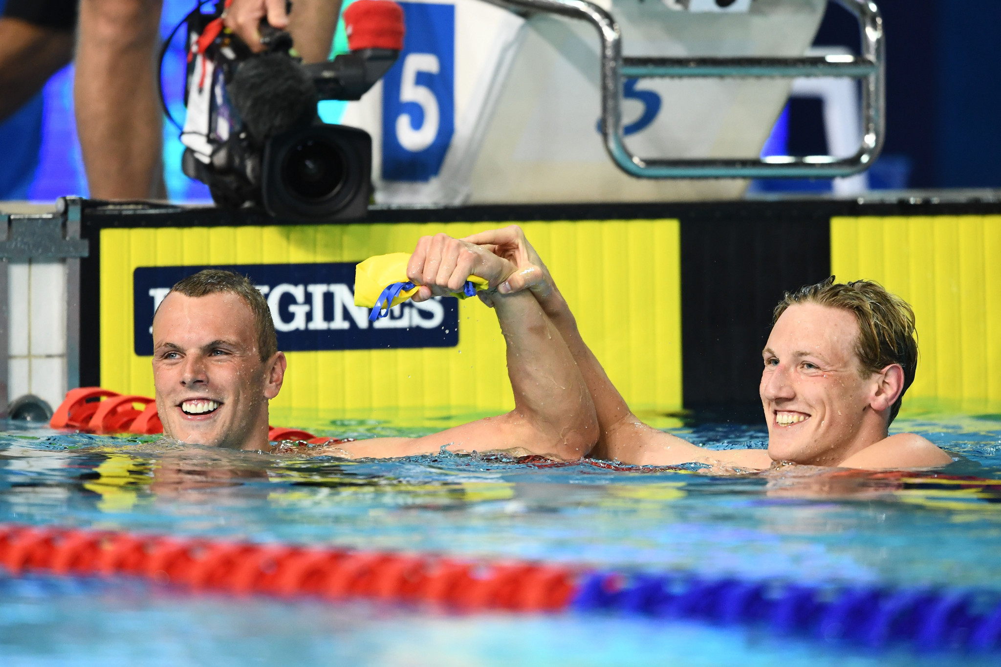 Australia's Kyle Chalmers, left, celebrates with Mack Horton after winning the 200m freestyle ©Getty Images