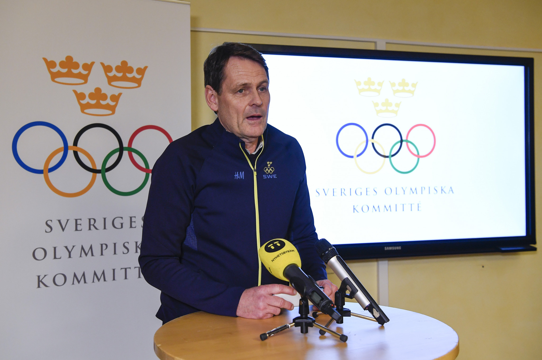 Swedish Olympic Committee chief executive, Peter Reinebo pictured speaking about the potential Stockholm 2026 bid, has risked an IOC warning after speaking about rival contenders ©Getty Images