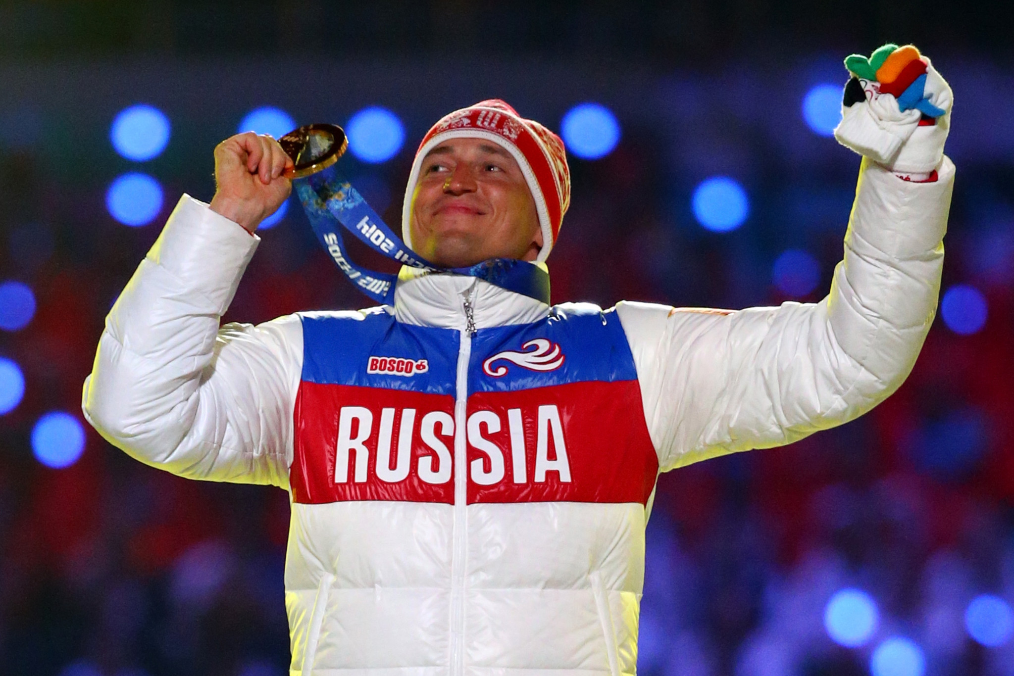 Alexander Legkov celebrates Olympic gold at Sochi 2014, a medal which was taken from him before being reinstated ©Getty Images