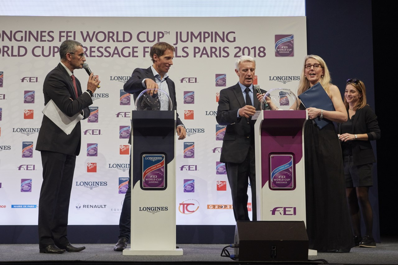 Sweden's Henrik von Eckermann, centre left, and French rider Roger Yves Bost, centre right,  pictured at tonight's draw at Paris City Hall for starting order of the Longines FEI World Cup Jumping Final ©FEI