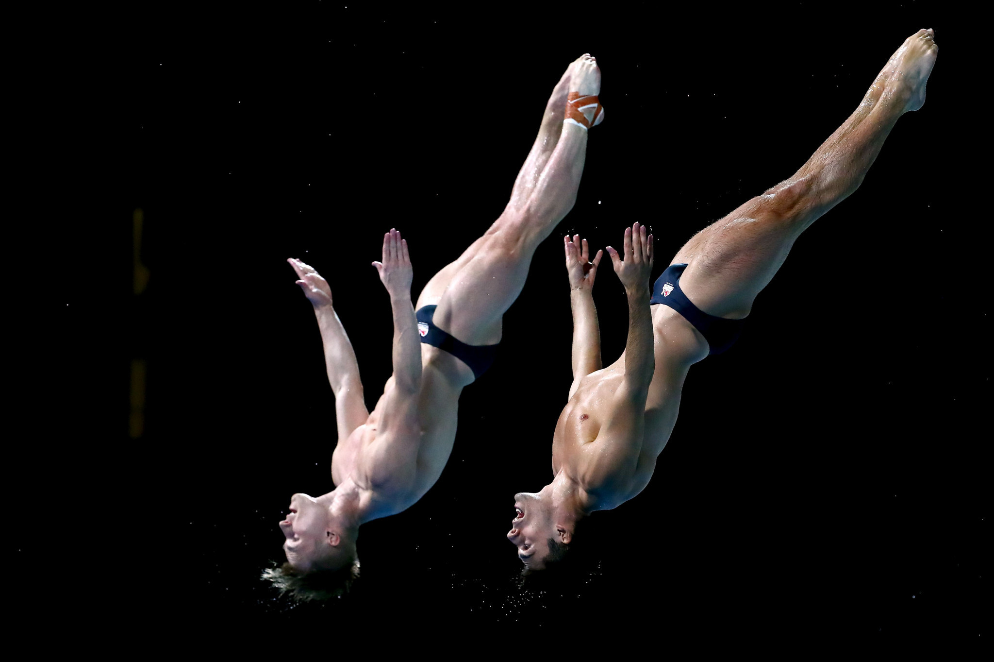 Reigning champions defend Commonwealth Games 3m synchronised springboard title as Laugher completes golden hat-trick