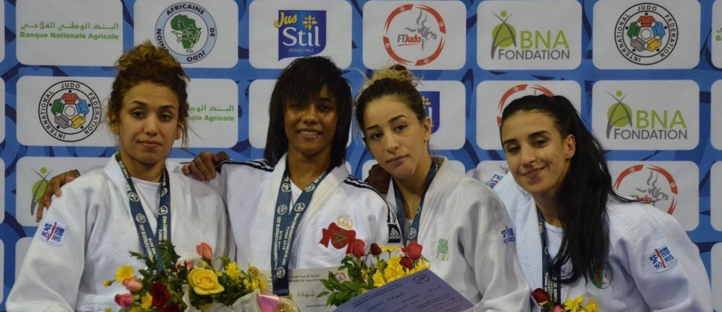 Fatima El Qorachi of Moroco, second left, denied Tunisia's women a hat-trick of wins on day three of the African Judo Championships in Tunis with victor in the under-52kg category ©IJF