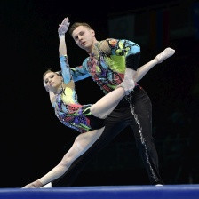 Russia's Marina Chernova celebrated a record third consecutive mixed pair gold medal ©FIG