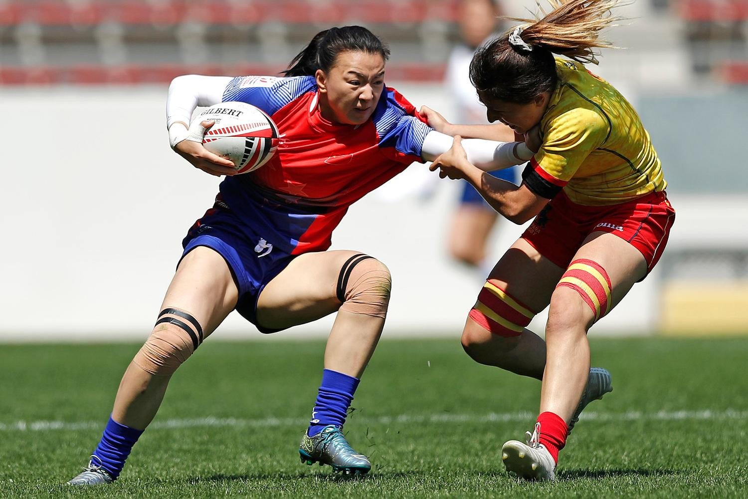 China and Spain both reached the last eight on a day of surprises ©World Rugby