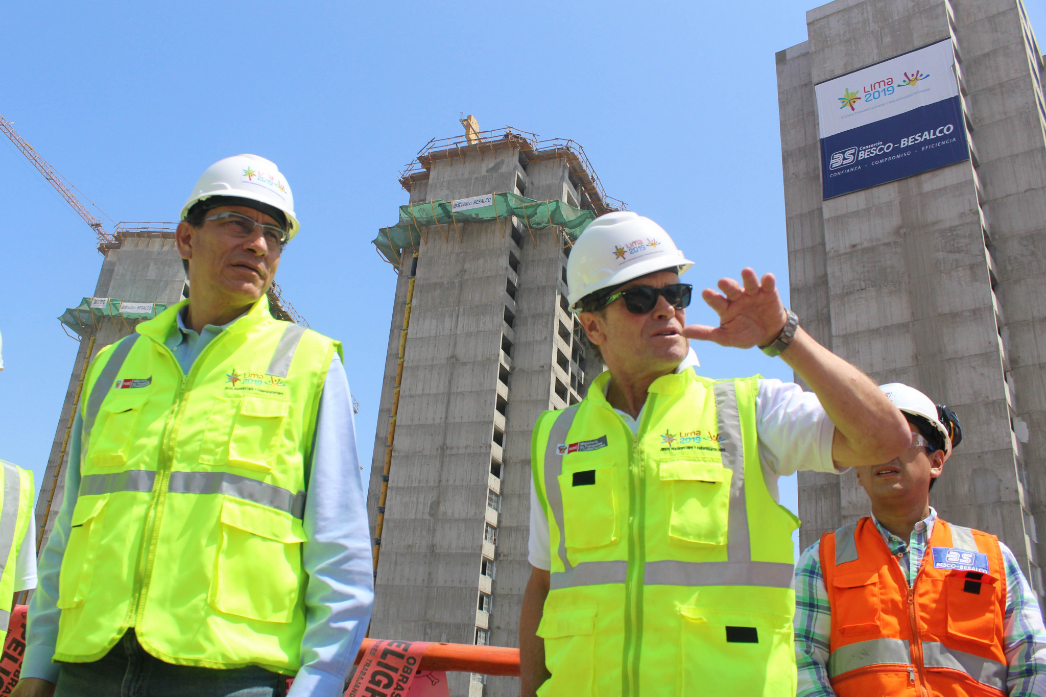 Lima 2019 President Carlos Neuhaus, right, guided President Martín Vizcarra Cornejo, left, around the Pan American Village as they inspected the progress so far ©Lima 2019