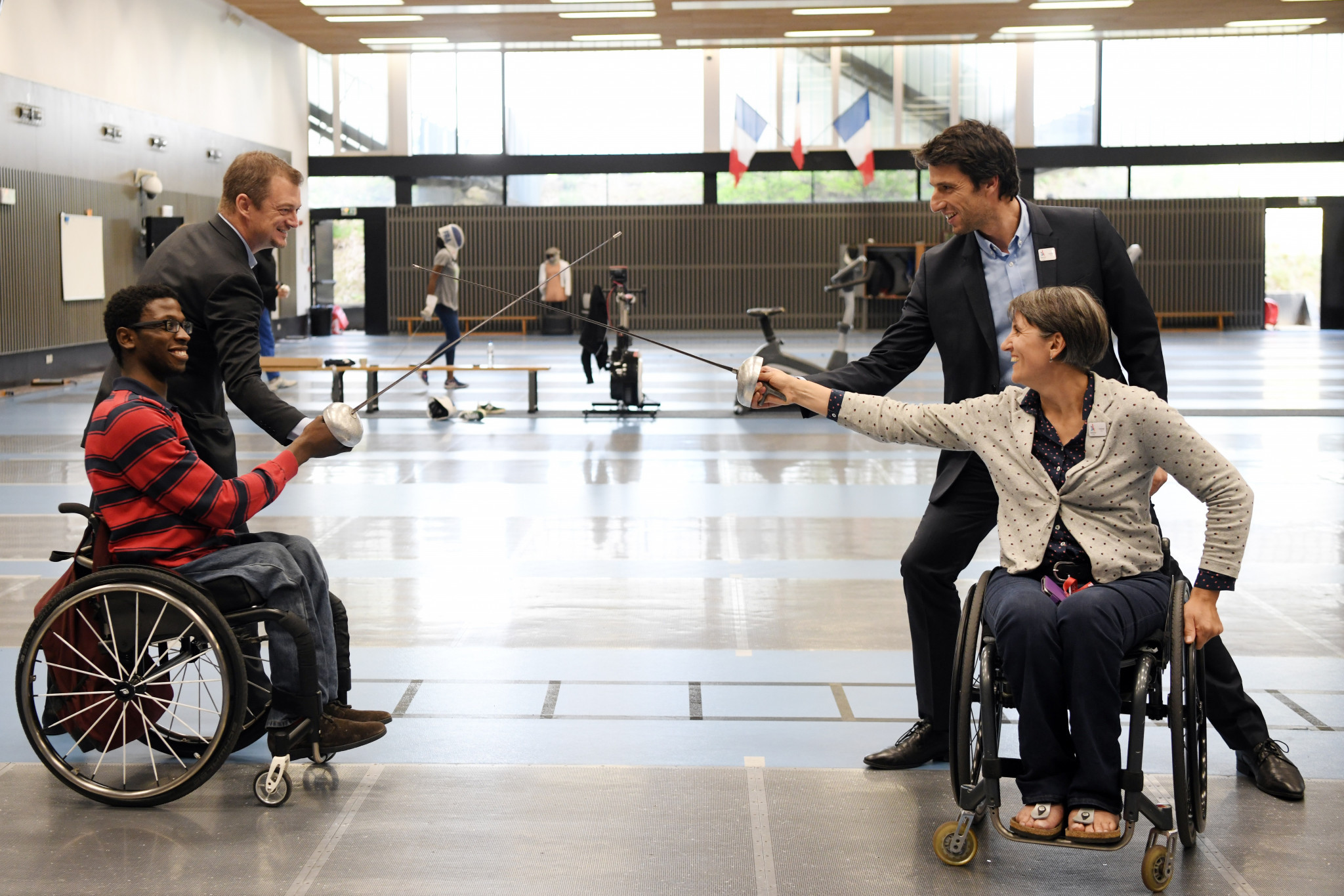 IPC President Andrew Parsons, left, and Paris 2024 counterpart Tony Estanguet, right, tried their hand at fencing ©Paris 2024