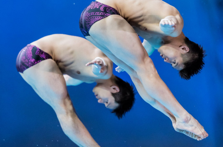 Qui Bo and Yang Jian were untouchable in  the men's 10-meter synchro event as they contributed one of three Chinese golds on day one of the FINA Diving World Series third leg at the Montreal Olympic pool ©FINA