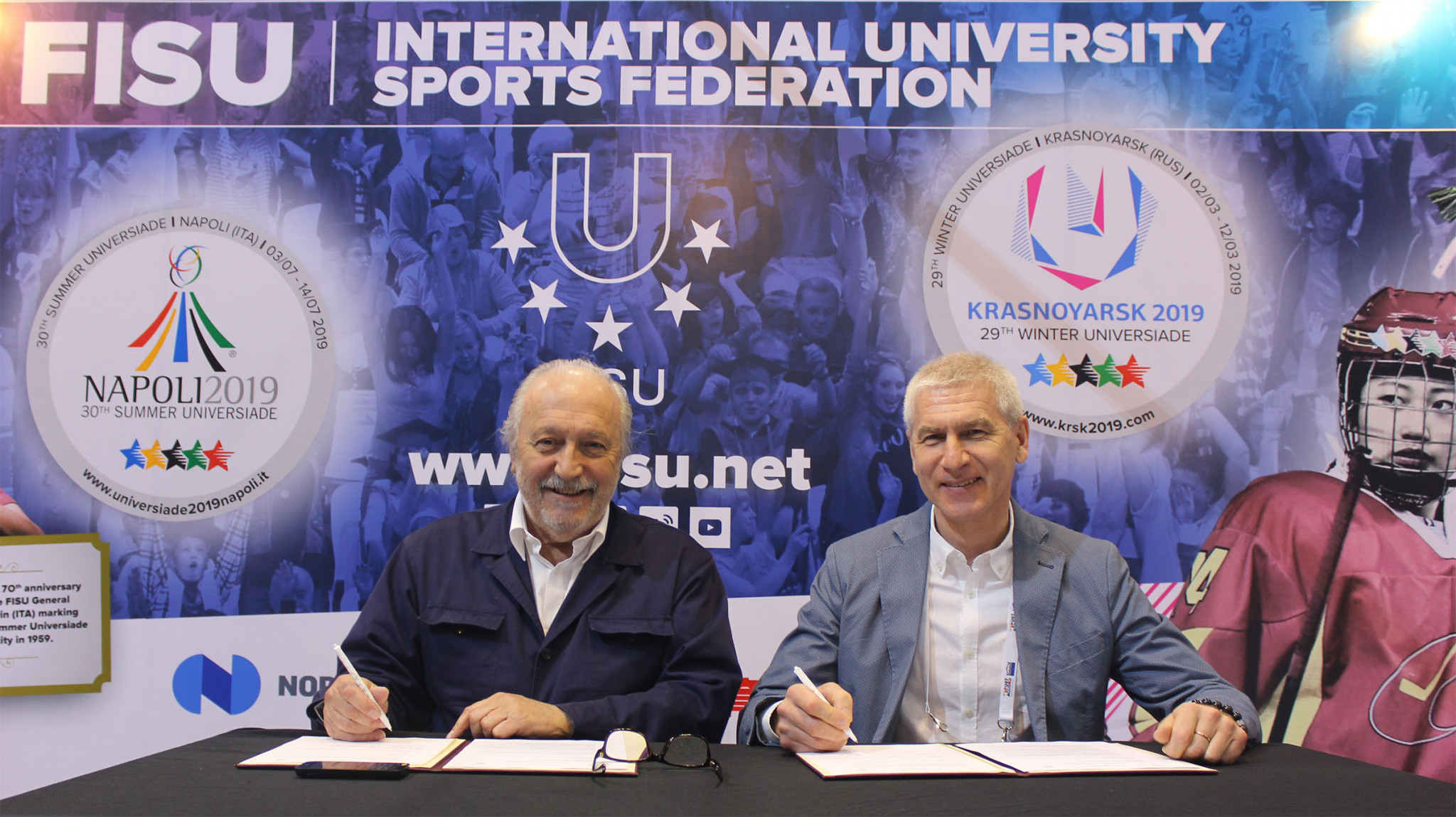 WSF President Jacques Fontaine, left, and FISU President Oleg Matytsin, right, was signed at last month's SportAccord Summit ©FISU