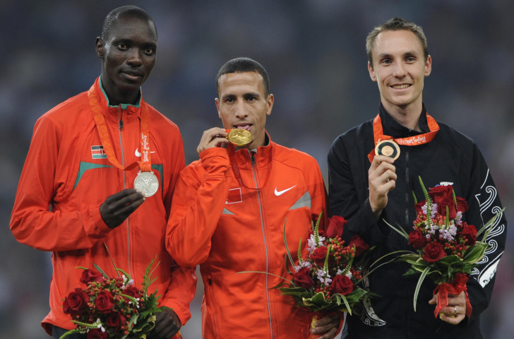 Asbel Kiprop, pictured left on the Beijng 2008 Olympic podium, moved up to gold when Rashid Ramzi of Bahrain was subsequently disqualified for doping - but he is now reported to be facing doping charges himself ©Getty Images