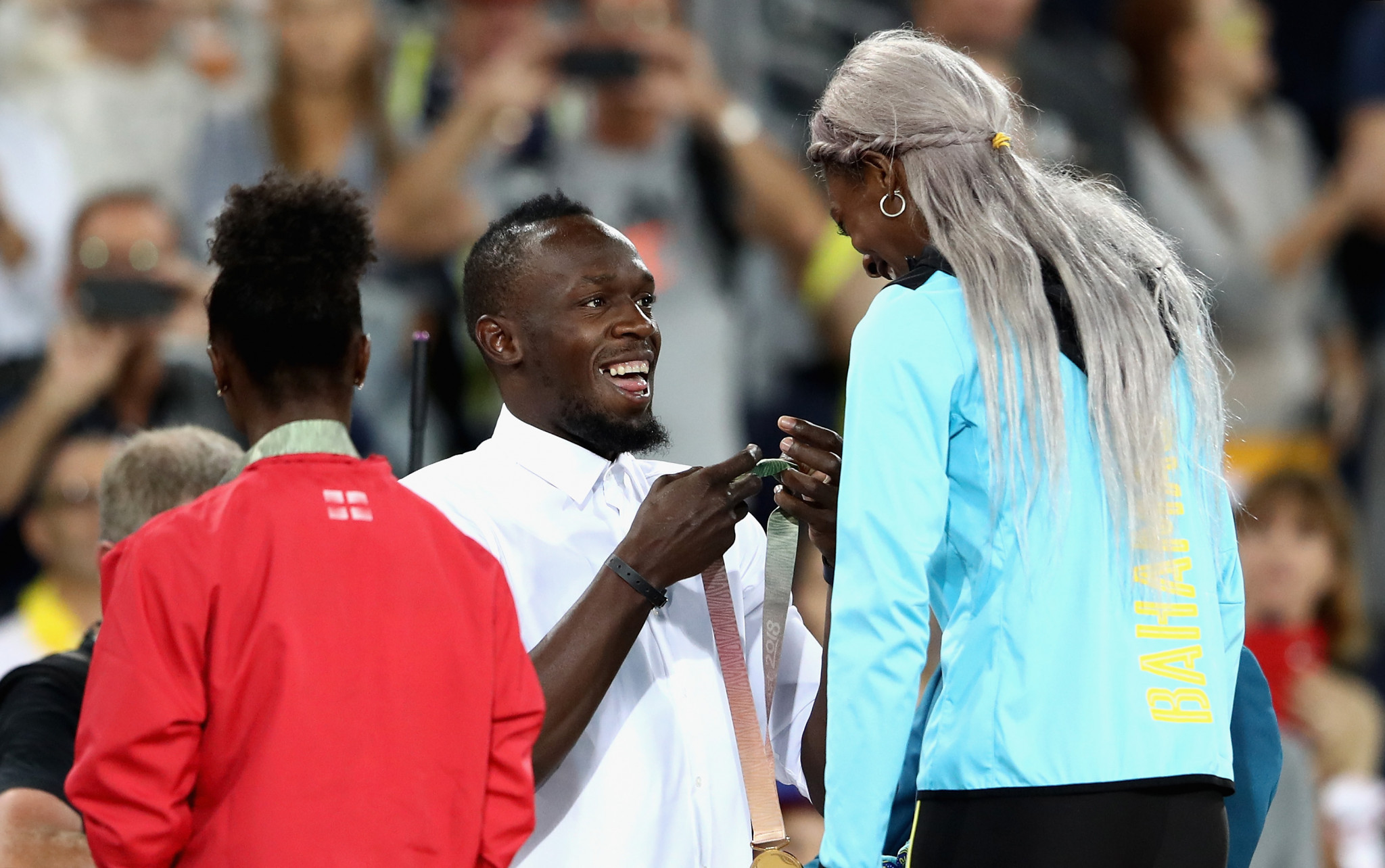 Shaunae Miller-Uibo, pictured receiving her Commonwealth 200m gold medal from Usain Bolt last month, will start the defence of her Diamond League title in Shanghai tomorrow ©Getty Images