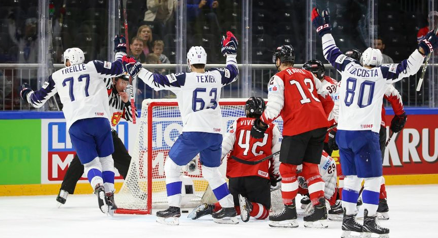 France also gained a key win today over Austria ©IIHF
