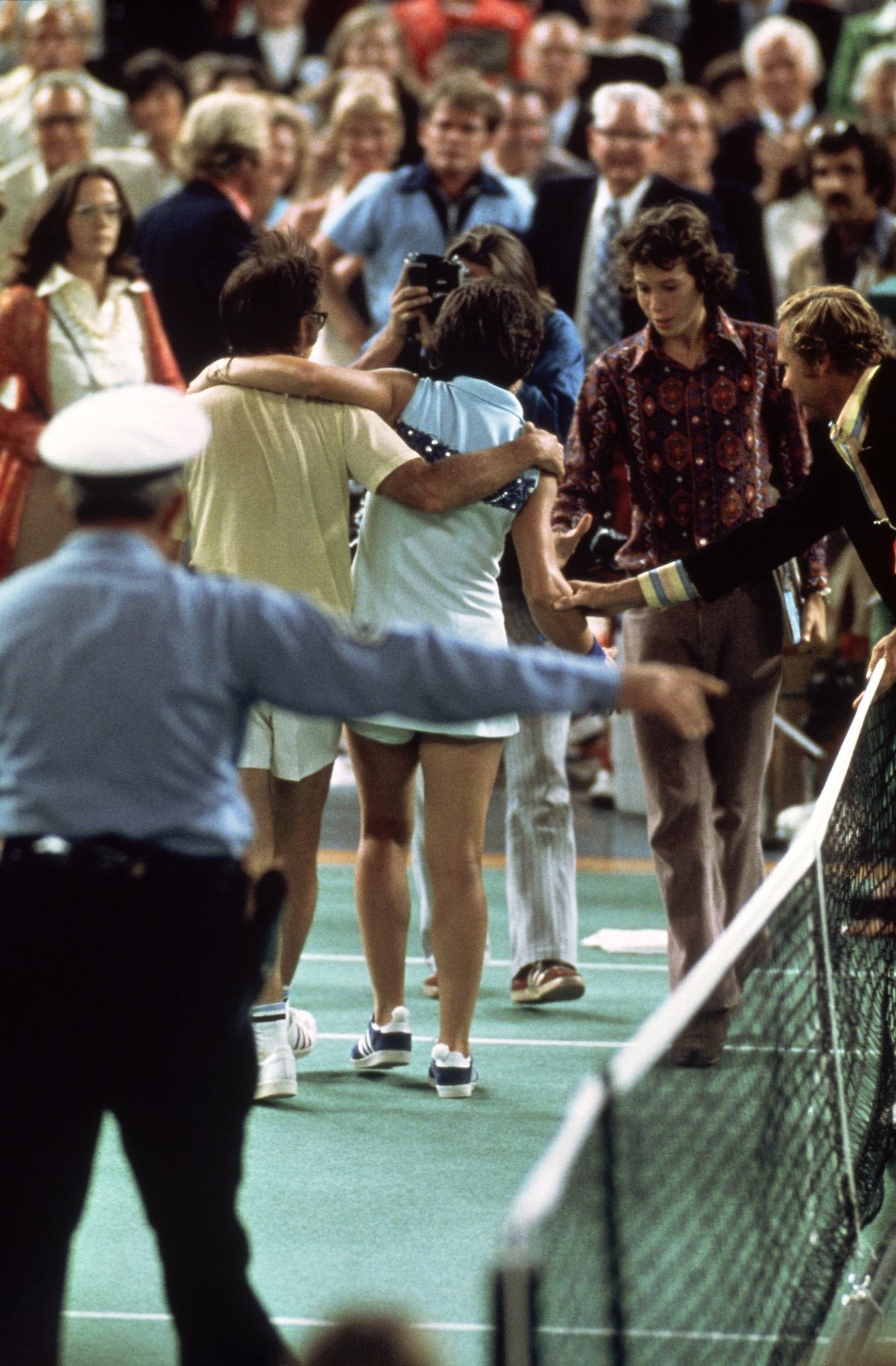 Bobby Riggs and Billie Jean King leave the Houston Astrodome court after the latter's 6-4, 6-3, 6-3 win ©Getty Images