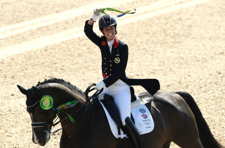 Britain's Charlotte Dujardin, pictured celebrating the successful defence of her Olympic individual dressage title in Rio, has consistently beaten male and female opponents at the highest level of sport ©Getty Images