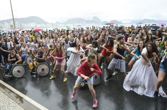 About 200 dancers, some of them in wheelchairs, took part and were led by choreographer Deborah Colker (in red)