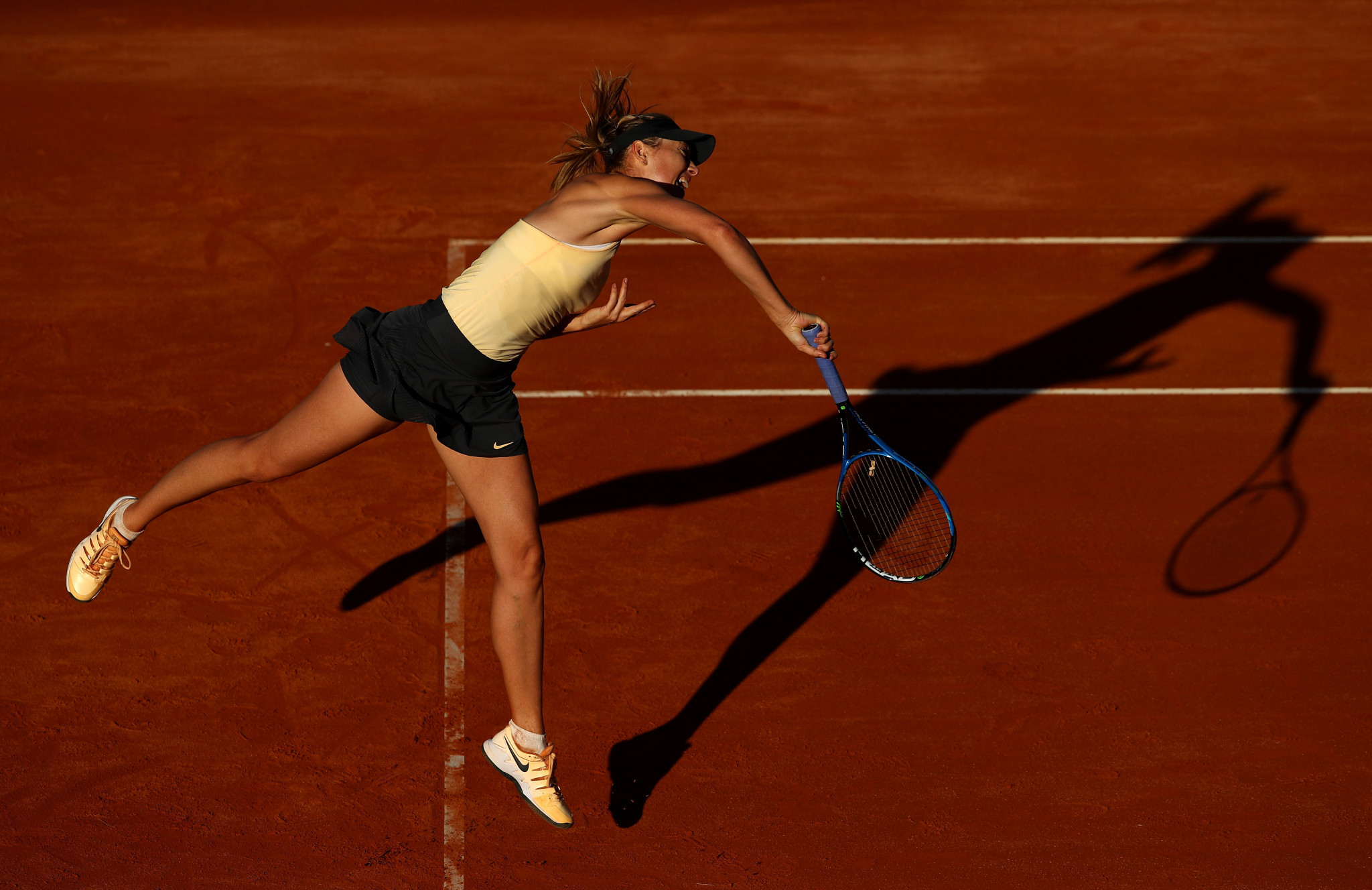 Sharapova emerges triumphant from close encounter at Italian Open