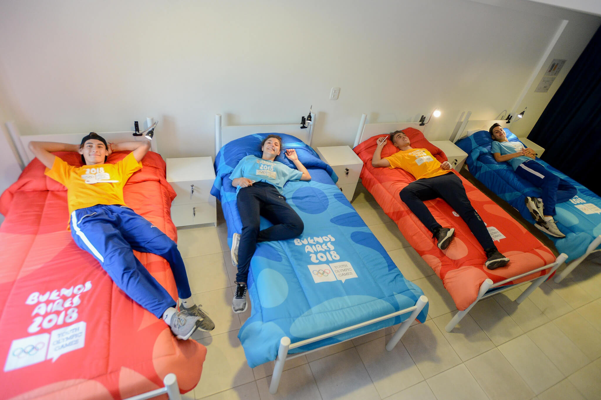 Aspiring athletes test out beds in the Village ©Buenos Aires 2018