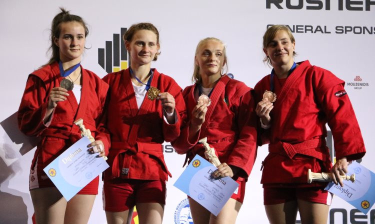 Belarus' Tatsiana Matsko, second from left, was one of nine gold medallists on day two of the 2018 European Sambo Championships in Athens ©FIAS