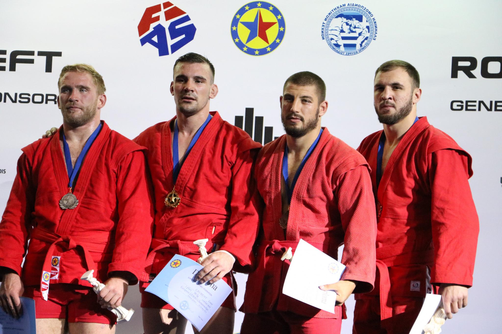 Ukraine's Dmytro Batok, left, had to settle for the silver medal ©FIAS