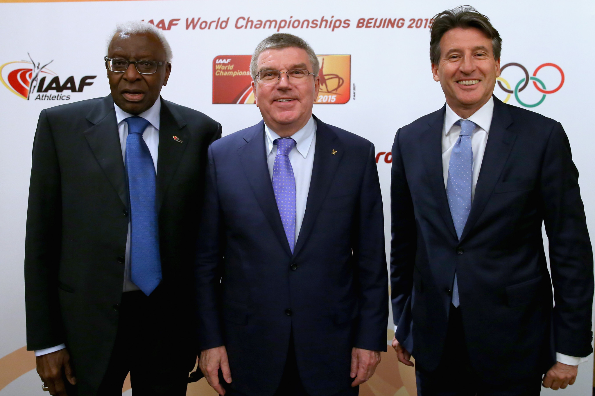 Lamine Diack, left, and Sebastian Coe, right, either side of IOC President Thomas Bach in 2015 ©Getty Images