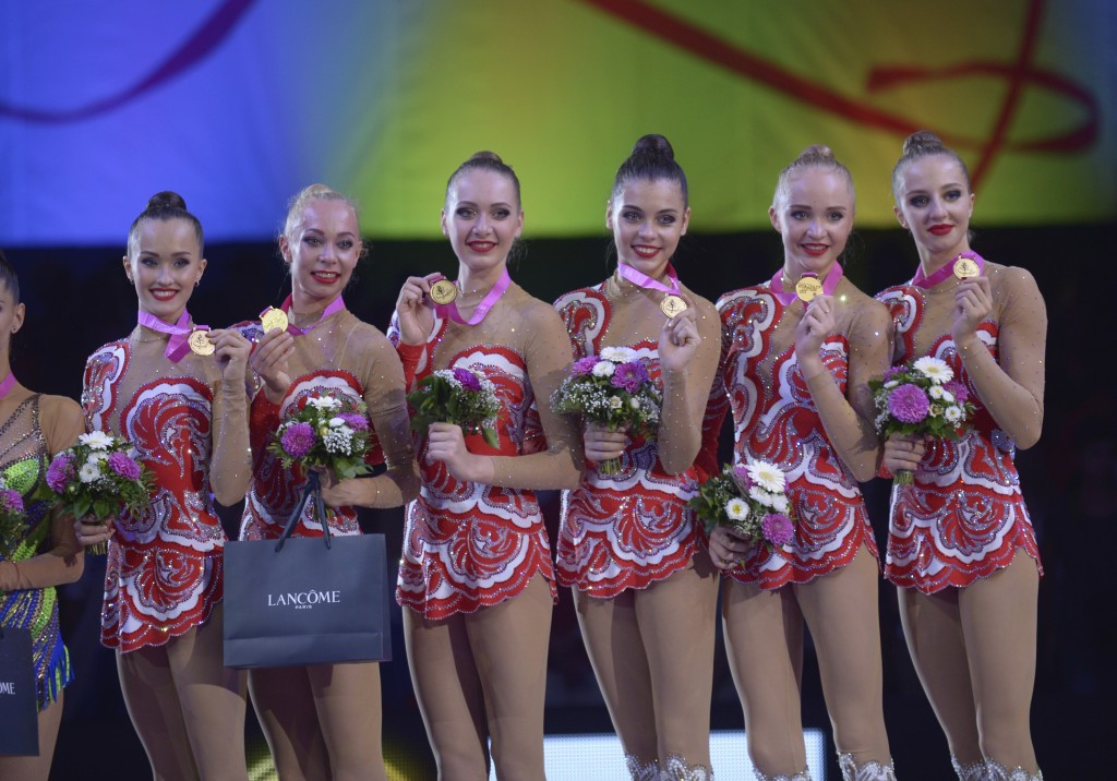 Russia celebrate after their group triumph at the World Championships ©FIG