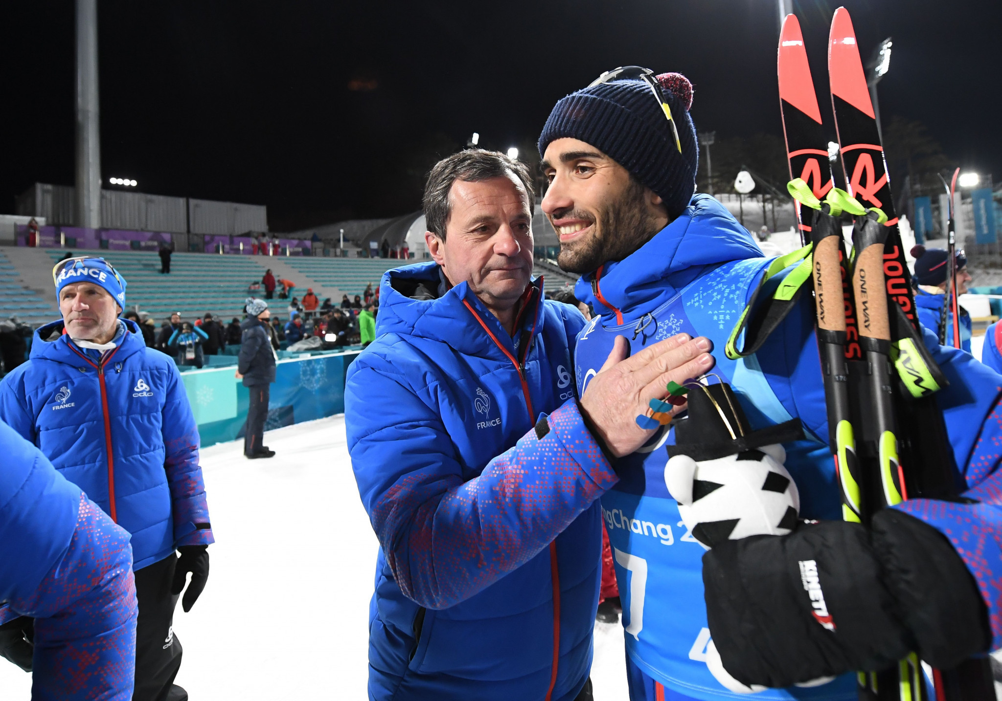 Michel Vion, centre, congratulates French biathlete Martin Fourcade during Pyeongchang 2018 ©Getty Images