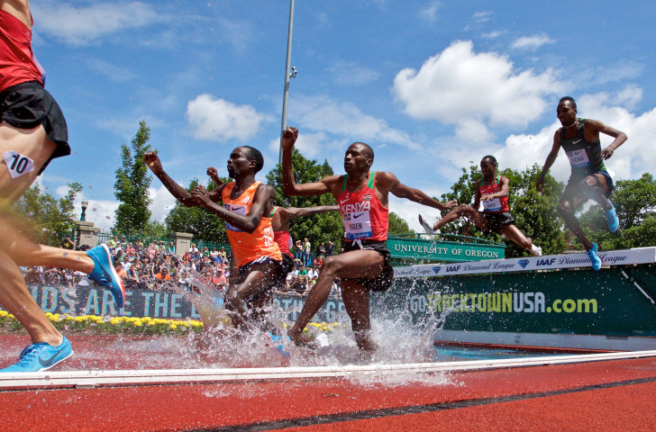 Kenya's Benjamin Kigen, centre, earned a surprise win in the 3,000m steeplechase on the final night of athletics at Hayward Field before it is re-developed ©Getty Images