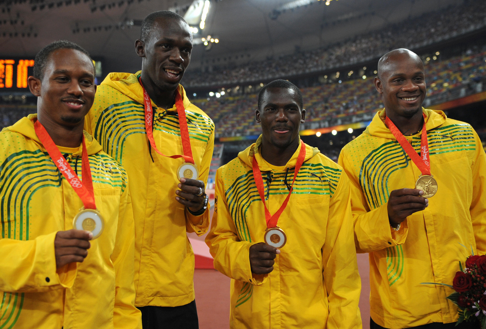 Nesta Carter, third left, celebrates along with his Jamaican team-mates at Beijing 2008 ©Getty Images