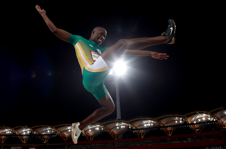 South Africa's star man Luvo Manyonga, pictured en-route to the Commonwealth long jump title last month, may upstage the sprinters as he faces a hugely talented field in Rome ©Getty Images