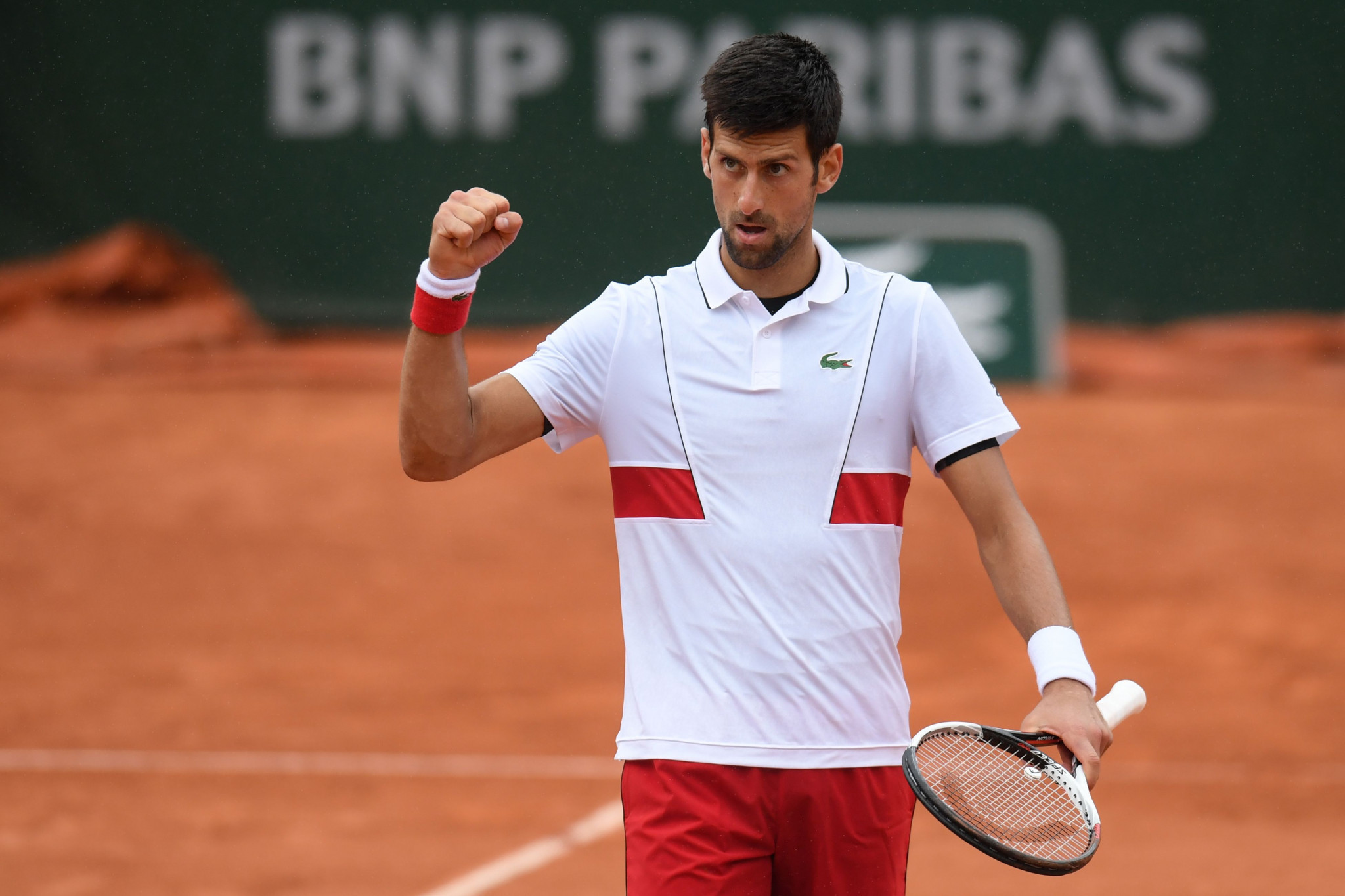 Djokovic and Zverev battle through to last 16 at French Open