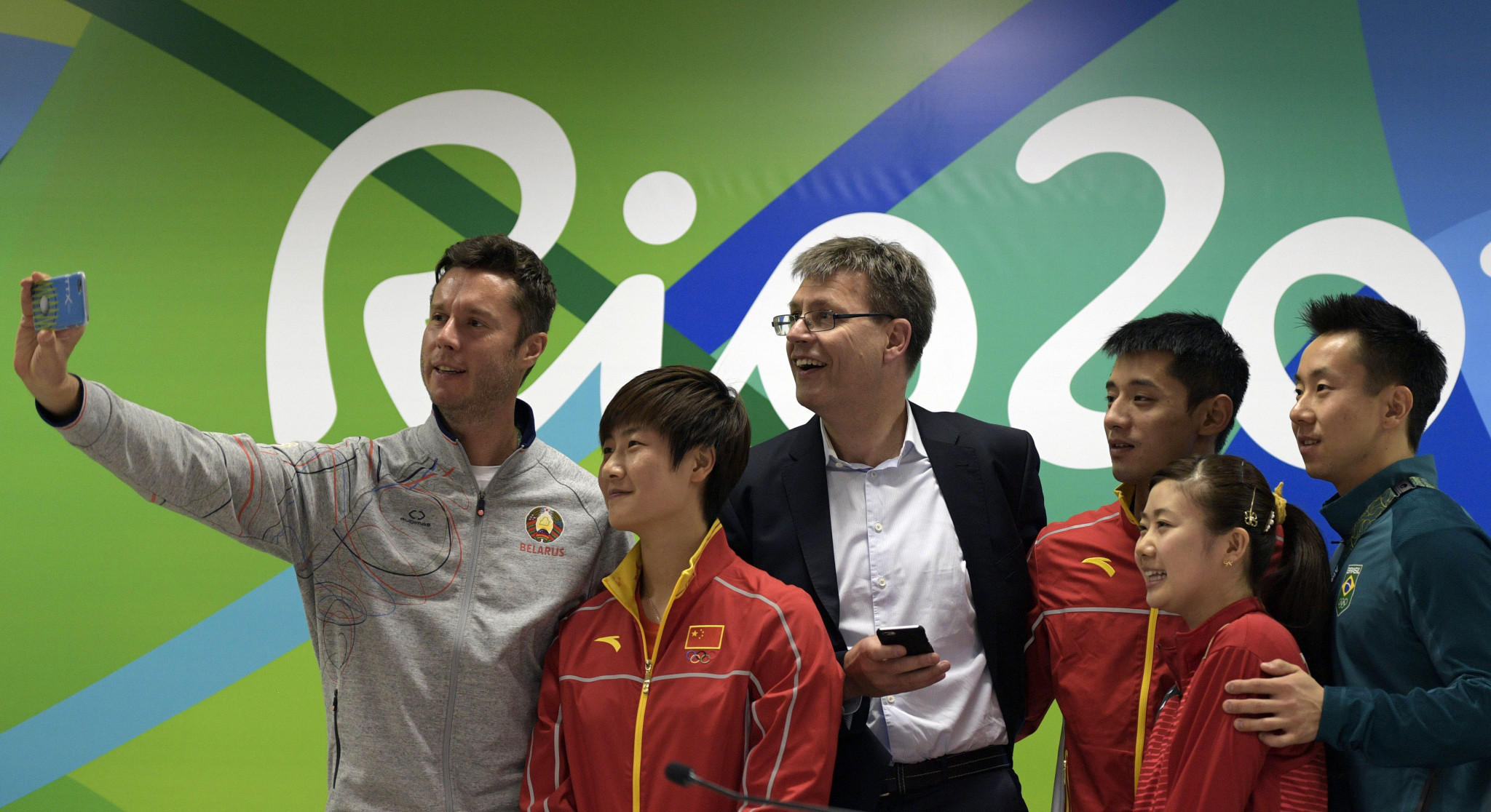 Thomas Weikert, centre, poses with leading table tennis players during Rio 2016 ©Getty Images