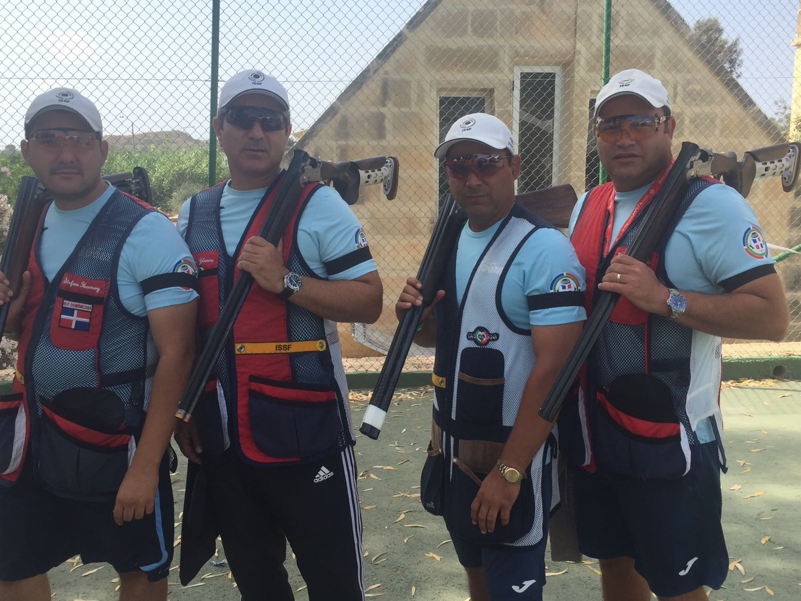 Dominican Republic competitors at the ISSF Shotgun World Cup in Malta wearing black armbands in support of Italy's suspended vice president Rossi ©FITAV