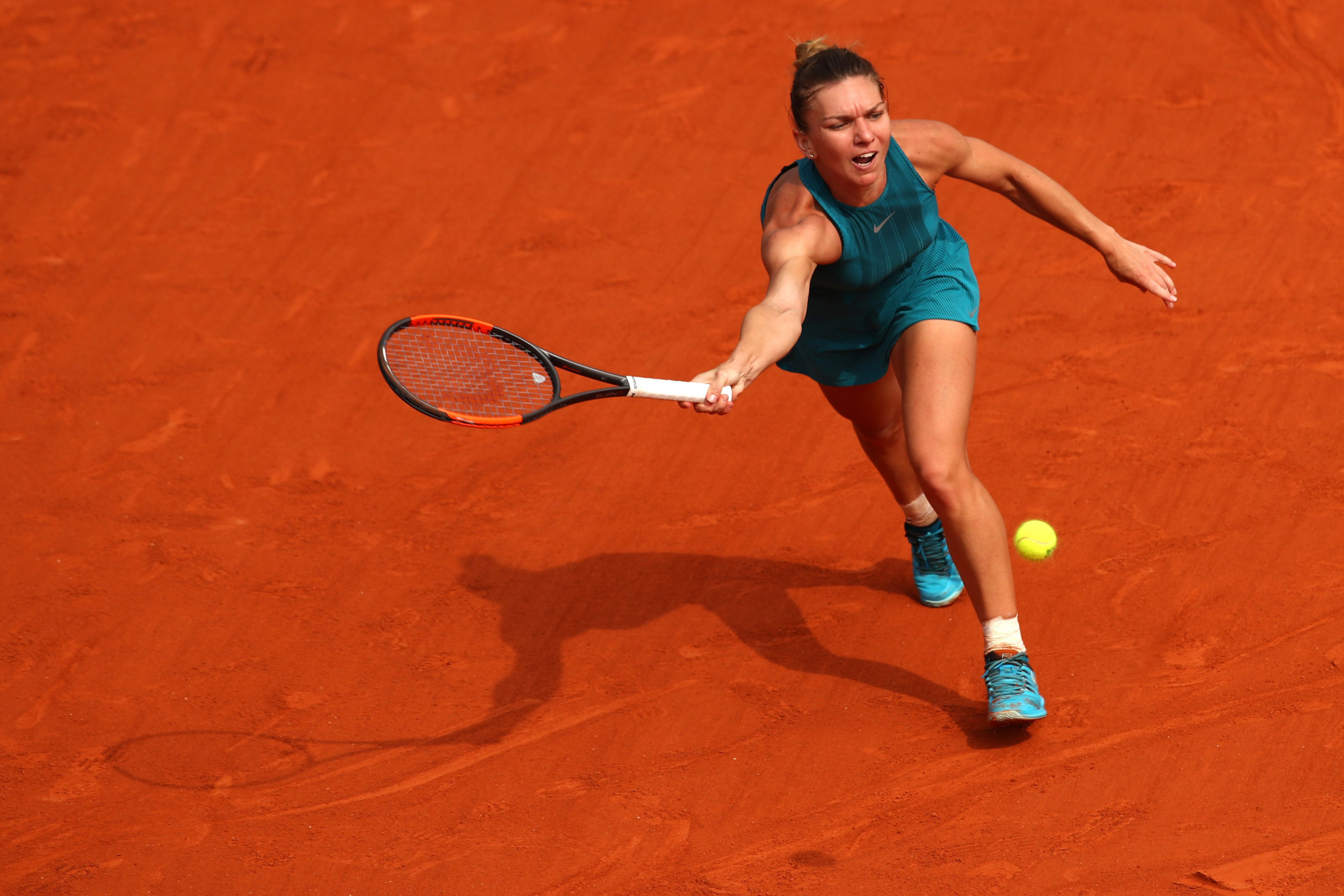 Halep clinches first Grand Slam title with three-set victory over Stephens at French Open