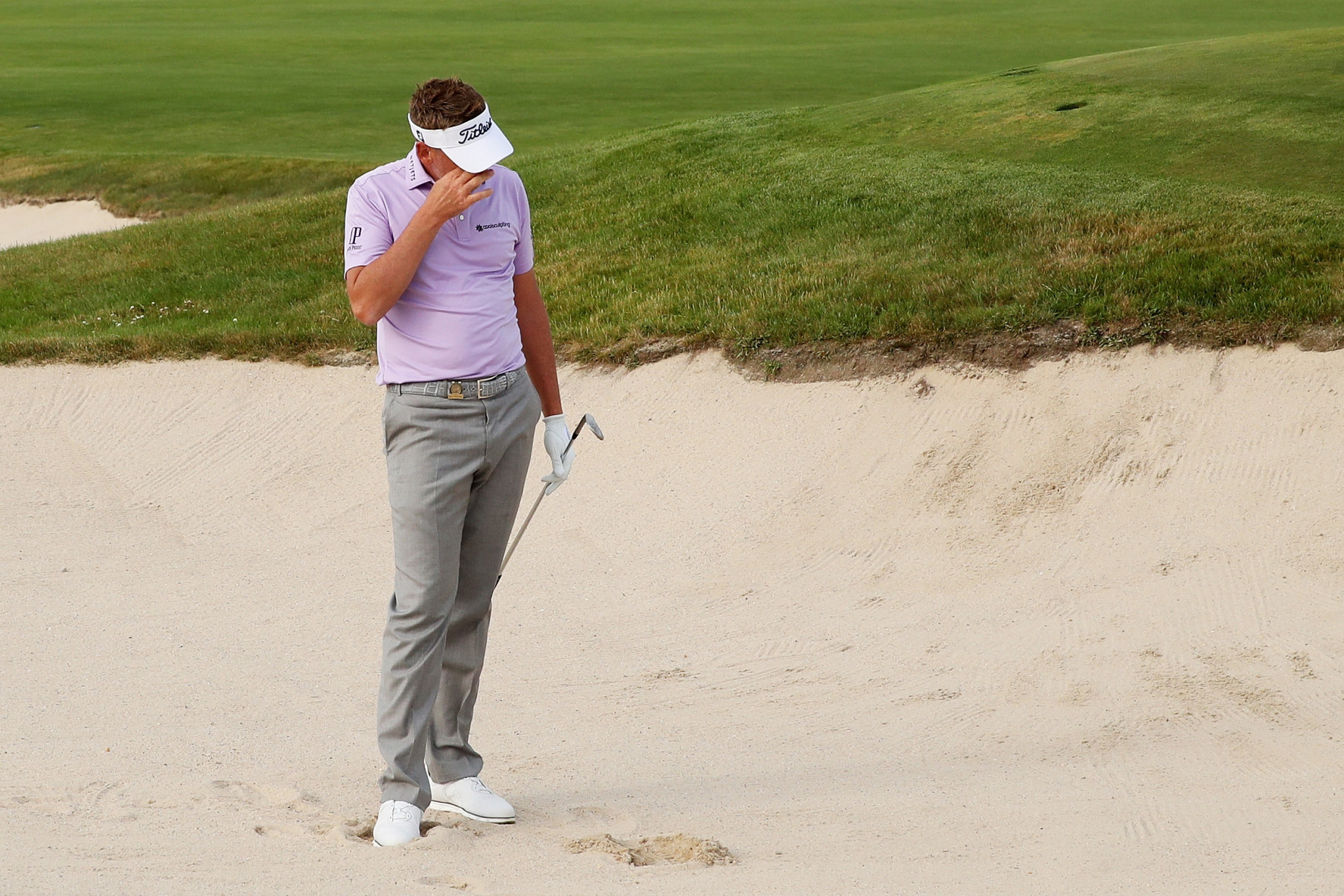 England's Ian Poulter dropped four shots in the final two holes to suffer a blow to his chances ©Getty Images